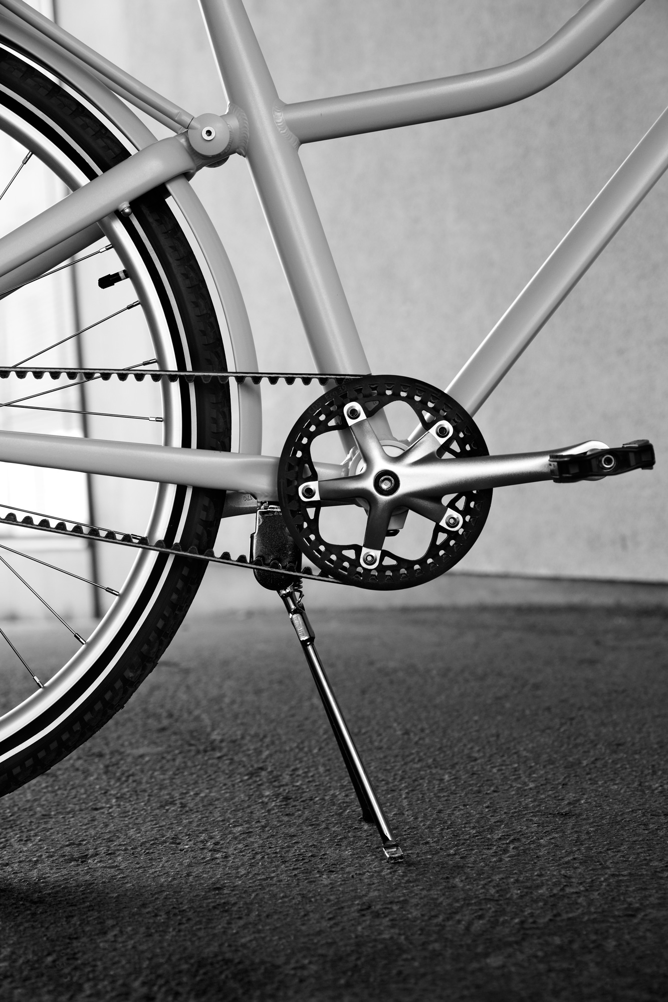 Parts of the frame, a wheel and the pedals of a bike.