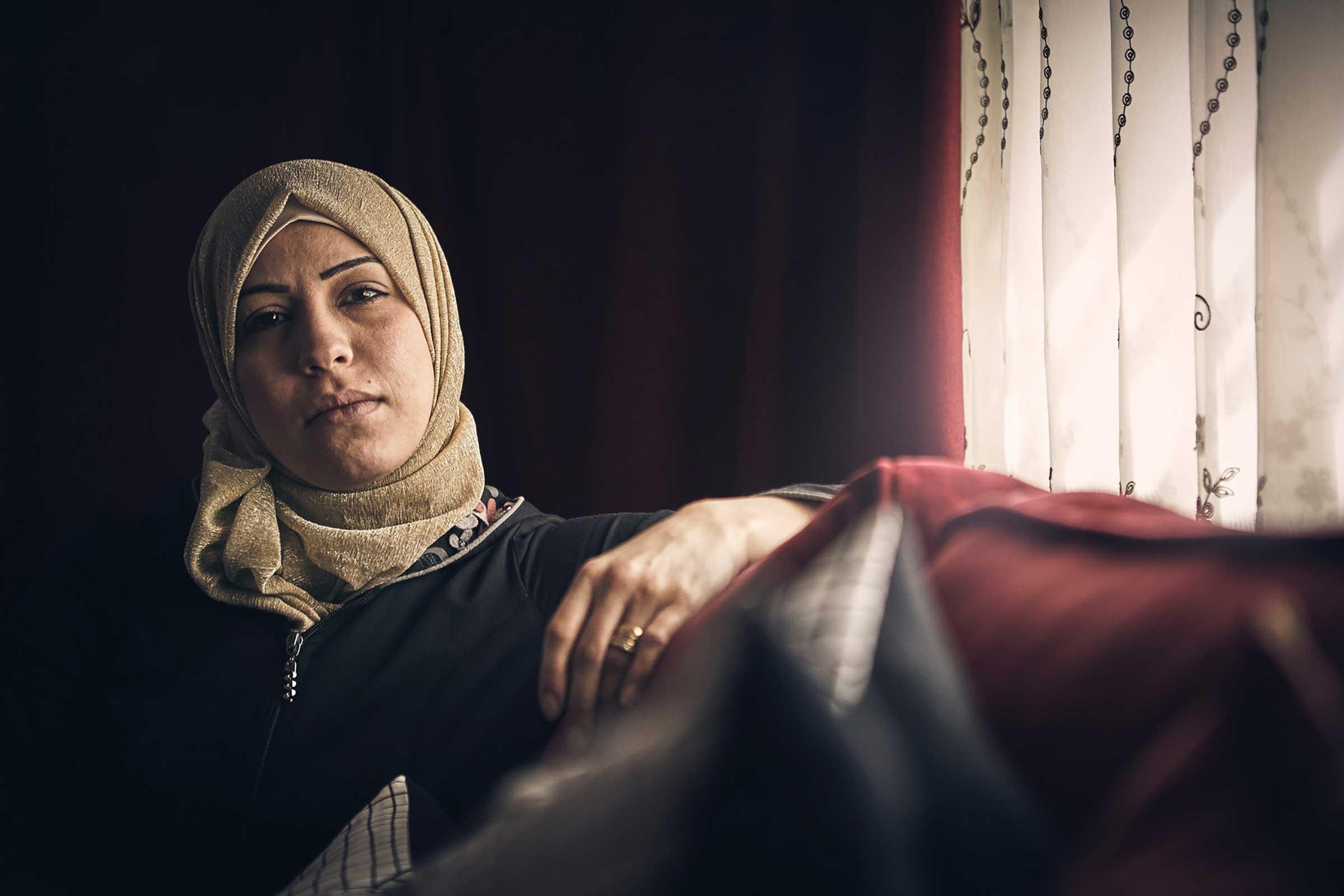 Woman sitting in sofa