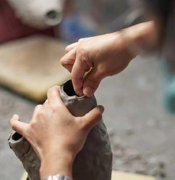 Hands clay vase
